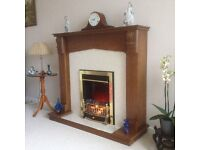 Electric fire and wooden surround with back board