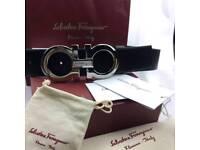 Silver oversized chrome buckle on black smooth soft mens leather belt ferragamo boxed smart