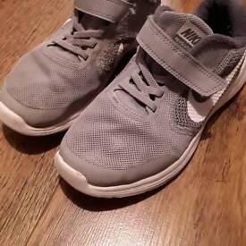 Boys grey Nike trainers