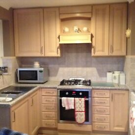 Full kitchen in light wood solid wood