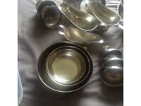 large assortment of stainless steel serving dishes /kitchen wares