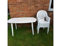 White garden table and four chairs