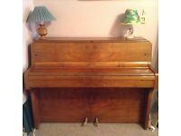 Compact upright piano.