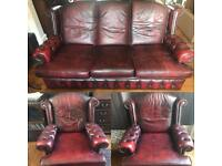 Vintage leather sofa and two arm chairs
