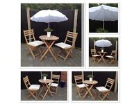 Garden table and chairs + seat cushions and parasol