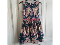 GIRLS NAVY BLUE AND FLOWER DRESS. AGE 8 YEARS BNWT
