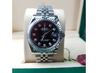 Rolex Datejust - Silver Jubilee Bracelet with Black Face and Diamond Markers. New, Boxed with Papers