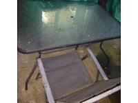 Oblong glass table and 4 chairs