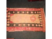 small hand-woven wool rug