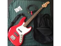 Red Westfield Bass guitar (LIKE NEW) + cord, bag and set of strings