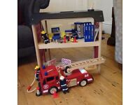 Pin toys wooden fire station, fire engine and accessories