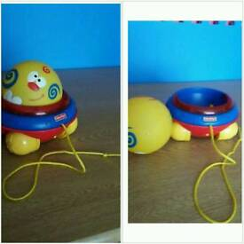 Fisher price vintage pull along musical ball toy