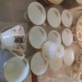 12 (plus 1) tea cups, 12 suacers