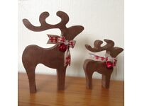 christmas star gazing reindeer decorations mother and baby copper brown red bells ribbon ribbon