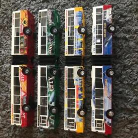 Collection of 4 colourful Bendy Buses.