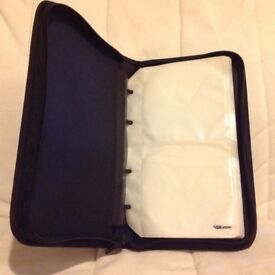 Zip travel case to hold maximum 48 CDs or DVDs