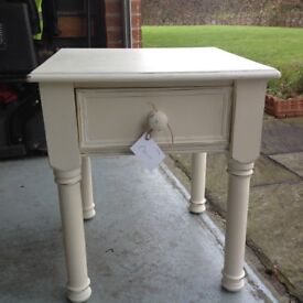 Cream Solid wood table with drawer.