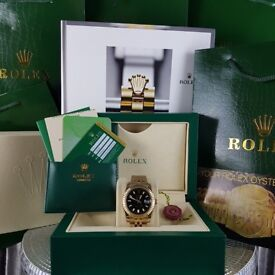 Gold Rolex Datejust, Black Face.  Comes Rolex Bagged, Boxed with Paperwork and one years warranty.