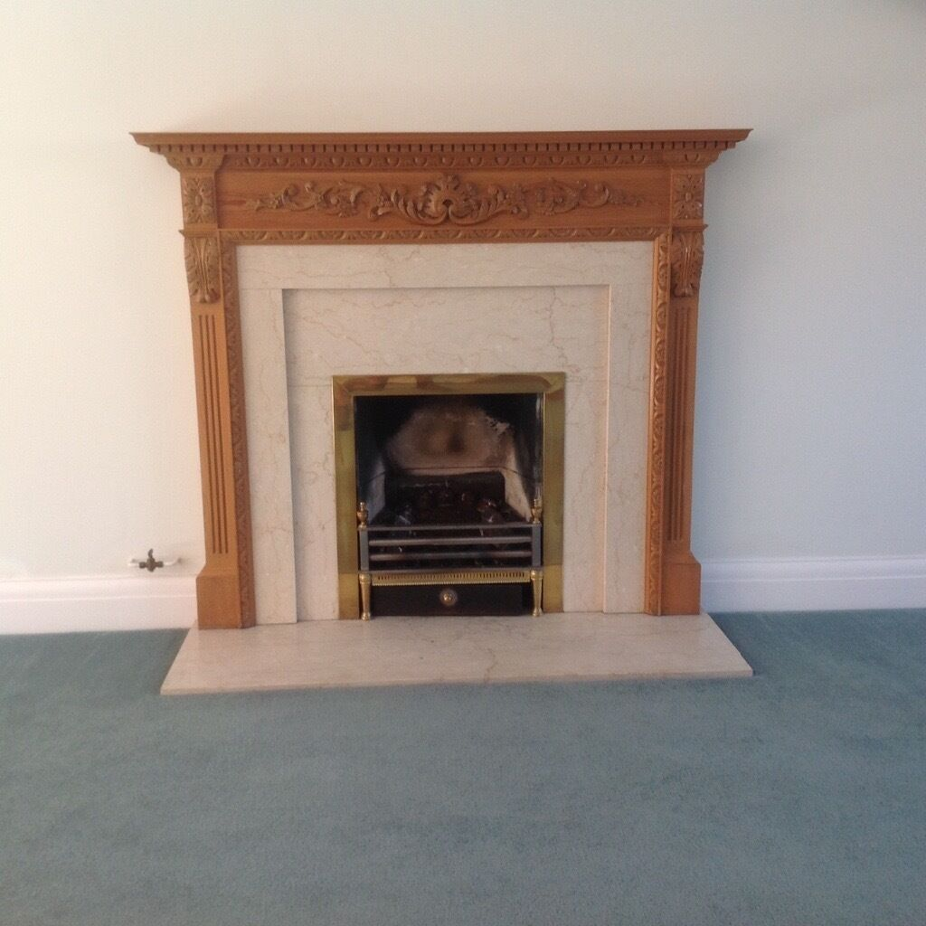 Marble fireplace plus wood mantelpiece and surround