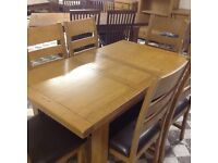 4 FT SOLID OAK EXTENDING TABLE AND 6 CHAIRS