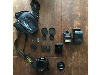 Nikon d3200 with a 18-200mm 3.5-5.6 lens + accessories