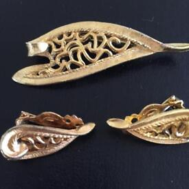 Vintage gold brooch and matching earring set.
