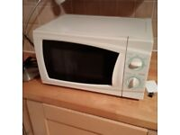 small microwave oven in excellent condition