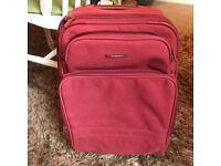 Red cabin size suitcase