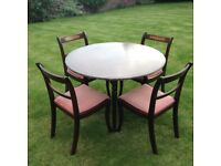 Round dining table plus four chairs