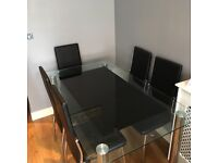 Glass dinning table an 6 leather chairs