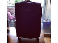 Black medium sized suitcase - new