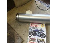 Suzuki GSXR 750 silencer and Haynes manual.
