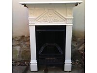 Victorian cast iron fireplace surround painted white