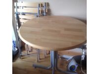 Round wooden table + chairs