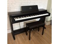 Yamaha Clavinova CLP-122S with stool.
