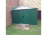 Green metal shed