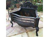 Baby It's Cold Outside! A traditional cast iron and steel fire basket with brass finials.