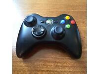 An XBOX 360 game pad controller