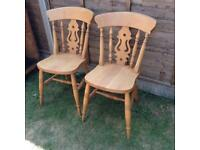 Two solid pine fiddle back chairs