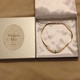 Christian dior necklace , in mint condition with box .