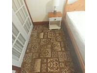 Brown axminster style carpet