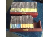 55 - CDs /booklet. Classical Composers Collection. New unopened still shrink wrapped. Wooden shelf.