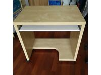 IKEA Birch Computer Table, small wooden desk with casters.