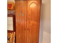 Solid pine wooden wardrobe with hanging rail