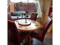 Oak table with lazy susan & 4 red leather chairs