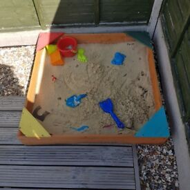 Wodden sand pit with sand