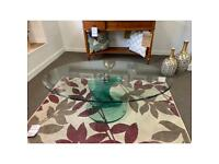 """Glass oval coffee table approx 47"""" in length"""