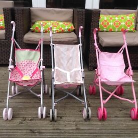 3 doll's pushchairs