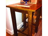 Very solid tall dark wood table and 4 stools