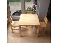 Child's solid wood table and 3 chairs